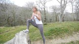 Woman doing stretching exercises in nature