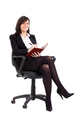 Young businesswoman accounting and sitting on a chair