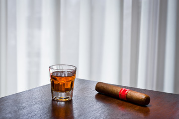 whiskey drink and cigar on old wood