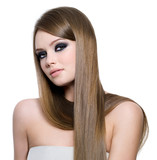 Portrait of beautiful teen girl with long straight hair