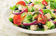 Vegetable salad with cheese, lettuce and tomatoes