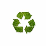 Recycle symbol covered  with grass