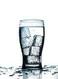 glass with cold purified water and ice, over white background poster