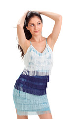 Young pretty woman in blue fringed sun-dress studio portrait