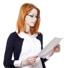 Portrait of a young business woman reading paper.