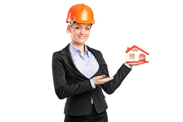 A forewoman holding a model house
