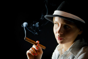 Woman in black hat with cigar