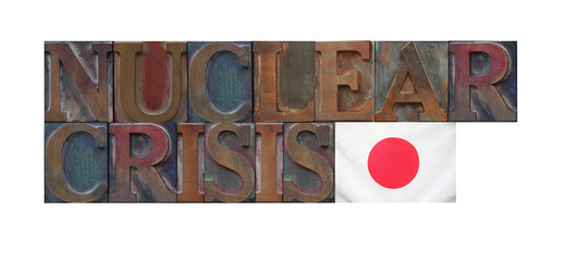 the words nuclear crisis with a Japanese flag
