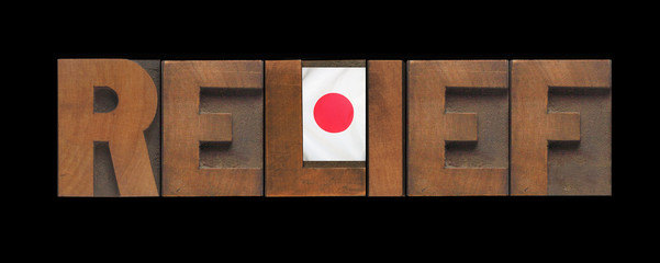 the word relief in old wood type with a Japanese flag