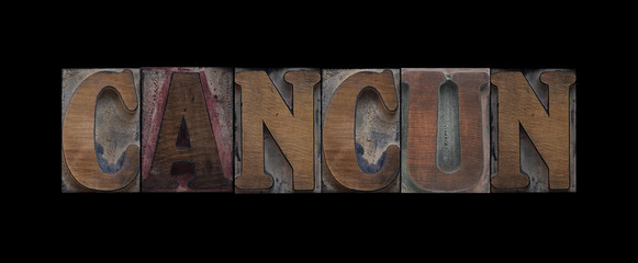 Cancun in old wood type
