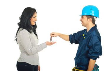 Repairman giving keys to woman