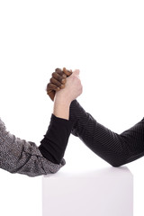 Arm wrestling between a black man and white woman