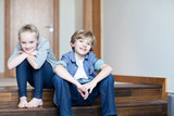 Brother and sister sitting on wooden steps