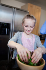 Girl preparing healthy meal in kitchen