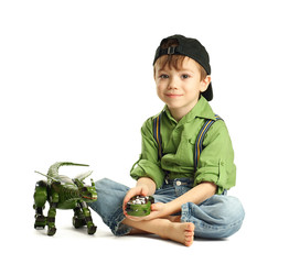 Young boy playing with dinosaur