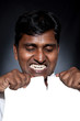Indian man tearing paper sheet