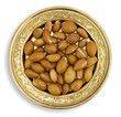 Argan fruits in a golden dish