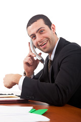 Smiling businessman talking at the phone