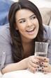 Hispanic Woman Laughing Drinking Glass of Water