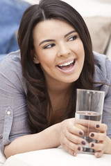 Hispanic Woman Laughing Drinking Glass of Water