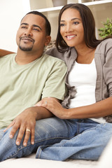 Happy African American Couple Sitting At Home