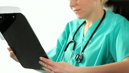 Nurse reading medical notes