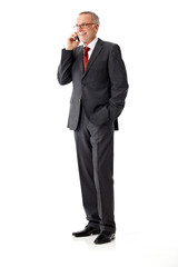 Isolated business senior man, standing and phoning