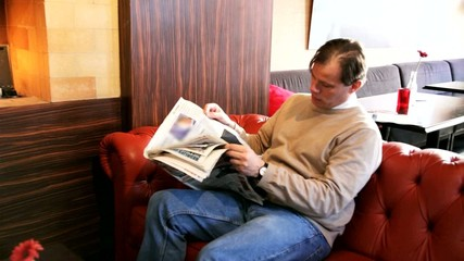 man in cafe with newspaper