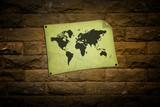 crumpled vintage world map on Brick walls background poster