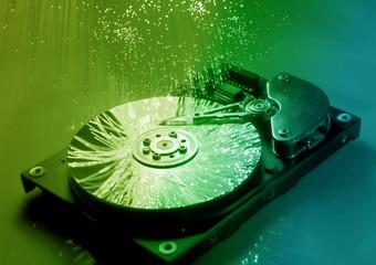 harddisk isolated on with fiber optical background .