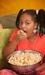 Little Girl Eats Popcorn