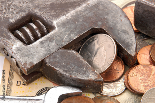 Making money, coin, dollar and wrench concept