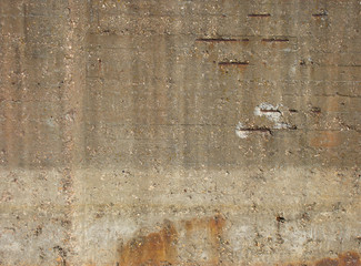 fortified concrete industrial wall with rusty metal showing