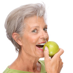 Senior woman with apple