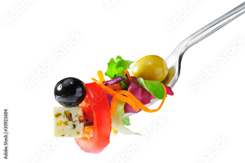 Vegetable salad with  cheese and olives isolated