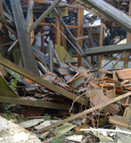 collapsed roof showing wood glass,and stone rubble poster