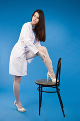 A pretty young nurse straightens stockings