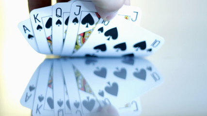 Hand showing royal flush of spade