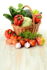 Vegetables in wicker basket on kitchen table