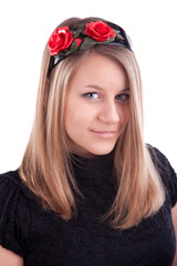 Young russian woman with red flowers in hair