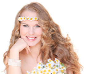 spring or summer woman with camomile flowers and long hair