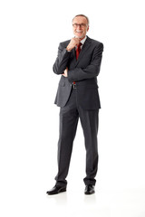 Isolated mature business man, standing, hand on chin