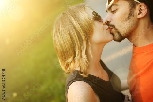 Couple in love kissing outdoors. Copyspace.