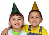 boy and girl with party hats together
