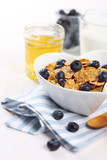 healthy breakfast- cereal with fresh blueberries, honey and milk