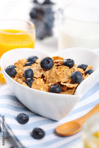 healthy breakfast- cereal with fresh blueberries, juice and milk