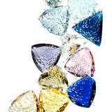 Multi-colored gems falling into water isolated on white. poster