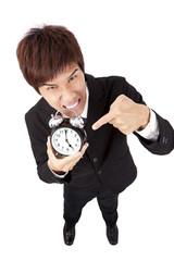 Time to go home.businessman holding a clock