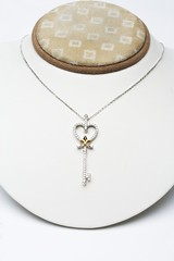 18k white gold key pendant with 0.50 carat diamonds