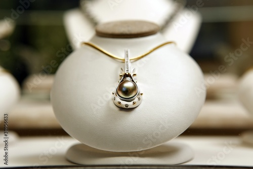 Round black pearl with diamonds